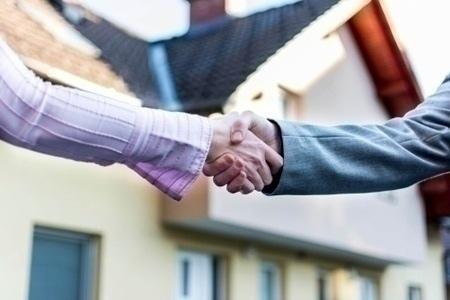 sold_home_handshake
