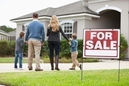 Family looking at house for sale