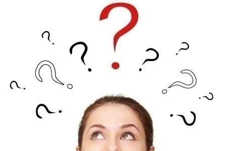 Thinking woman looking up on many question signs above head isol