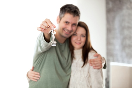 Happy young couple moving into a new home
