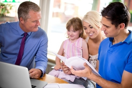 financial adviser or estate agent with client