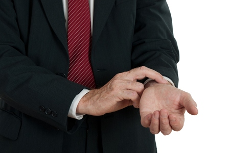 Business man checking pulse- stress, health concept, white backg