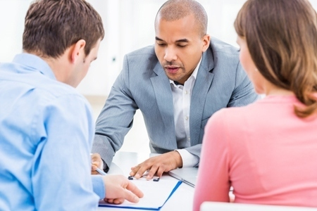 Couple meeting with their financial advisor.