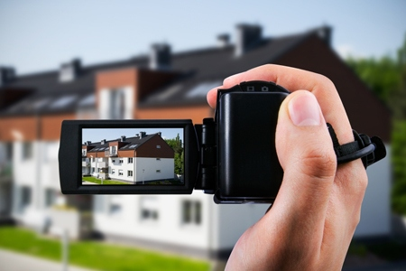 Video camera or camcorder recording new house