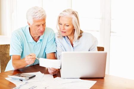 Senior Couple Calculating Home Finances