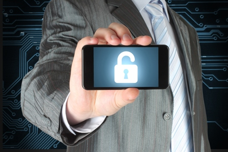 Businessman holds smart phone with open lock