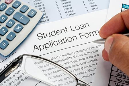 Student Loan application Form with pen, calculator and writing h