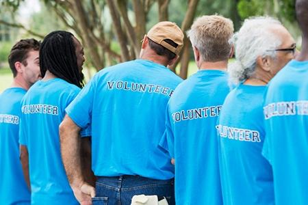 Group of men volunteering in a park