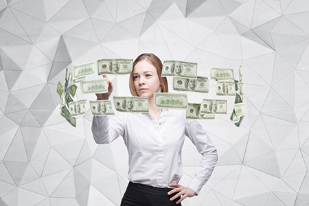 Young lady is controlling cash flow of the dollar notes. Contemporary background.