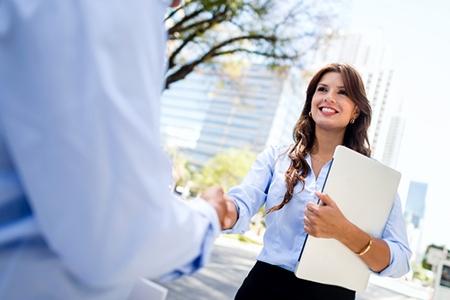 Business woman handshaking