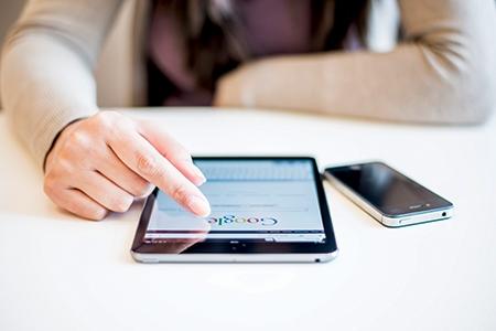 Woman holding Ipad Mini