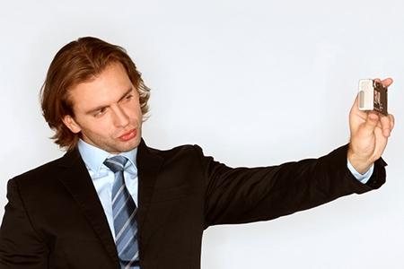 Businessman takes a self portrait