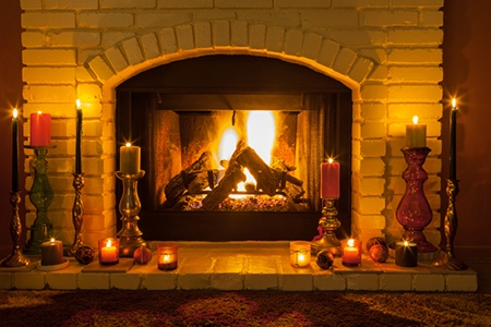 Cozy fireplace setting with candles (P)