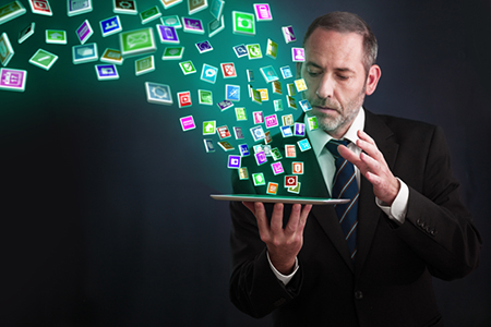 Tablet PC with cloud of application icons flying arround