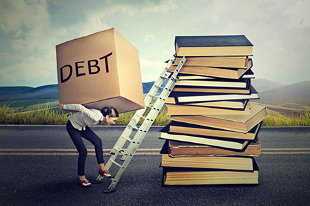 Student loan debt concept. Woman with heavy box debt carrying it