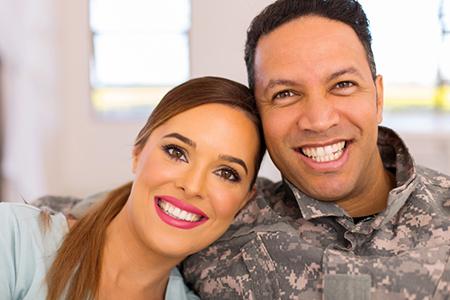 military couple sitting on sofa