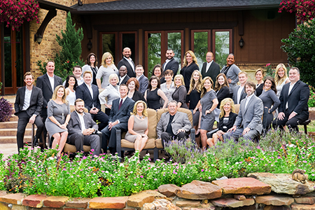 Russell Rhodes (front row, third from left) and The Rhodes Team have joined Berkshire Hathaway HomeServices PenFed Realty Texas.