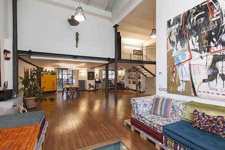 Close to the Semplon Park in the west of Milan, this modern loft is on sale for 1.8 million euros. Three bedrooms and four bathrooms are set over a living interior of approximately 300 square meters.