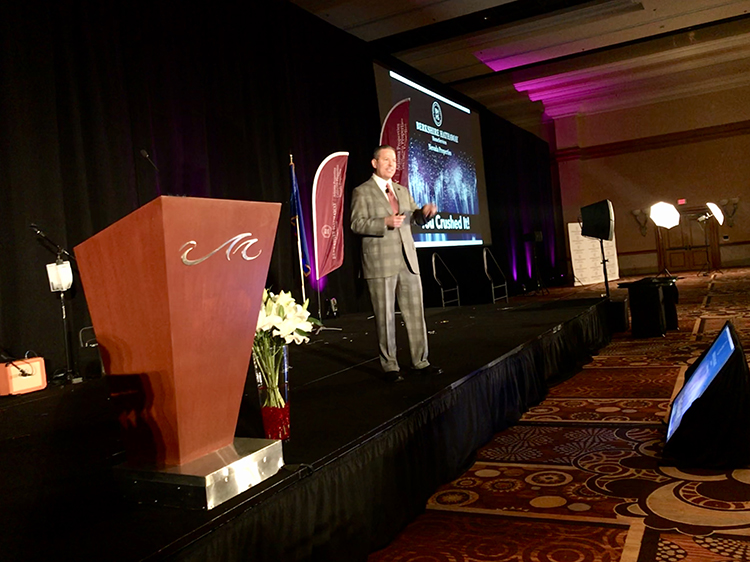 Americana Holdings CEO Mark Stark addresses attendees of the Berkshire Hathaway HomeServices Nevada Properties annual event.