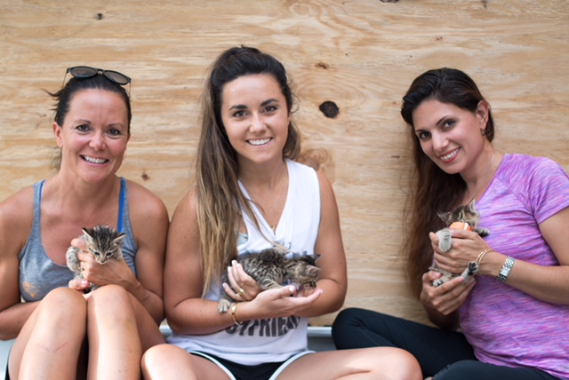 (L to R) Mother/daughter volunteers Susan Roadman and Mallory Pachtman; and Samira Davis, agent with Coldwell Banker Sea Coast Advantage and founder of Sea Coast Pet Sanctuary