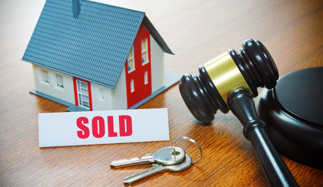 Pros and Cons of Buying a House at Auction