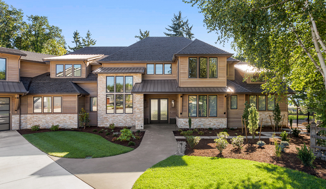 Beautiful Large Luxury Home Exterior On Bright Sunny Day With Green Grass And Blue Sky Rismedia